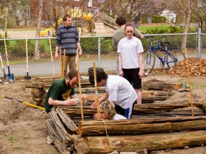 Aaron helping build garden beds at Heritage Academy School