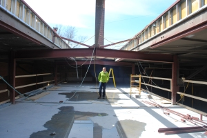 April 2012 - Tracey standing where our offices are now before we replaced the skylight.